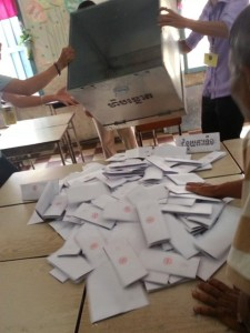 Election officials open a ballot box - Phnom Penh, Cambodia. (Credit photo: HONG Yao Nan, Comfrel observer from Taiwan)