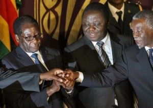Mugabe and Tsvangirai (Credit: DESMOND KWANDE/AFP/Getty Images)