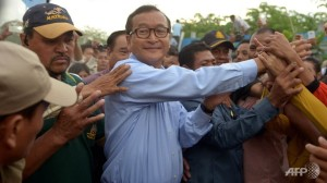 CNRP Leader Sam Rainsy greets the crowds (Credit: Creative Commons: AFP/Tang Chhin Sothy)