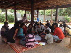 Interns leading a discussion in Ratanakiri province